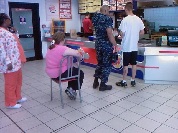Burger King Sitting Down on Chair In Line
